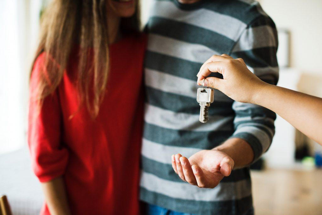 A couple receiving the keys to their house.