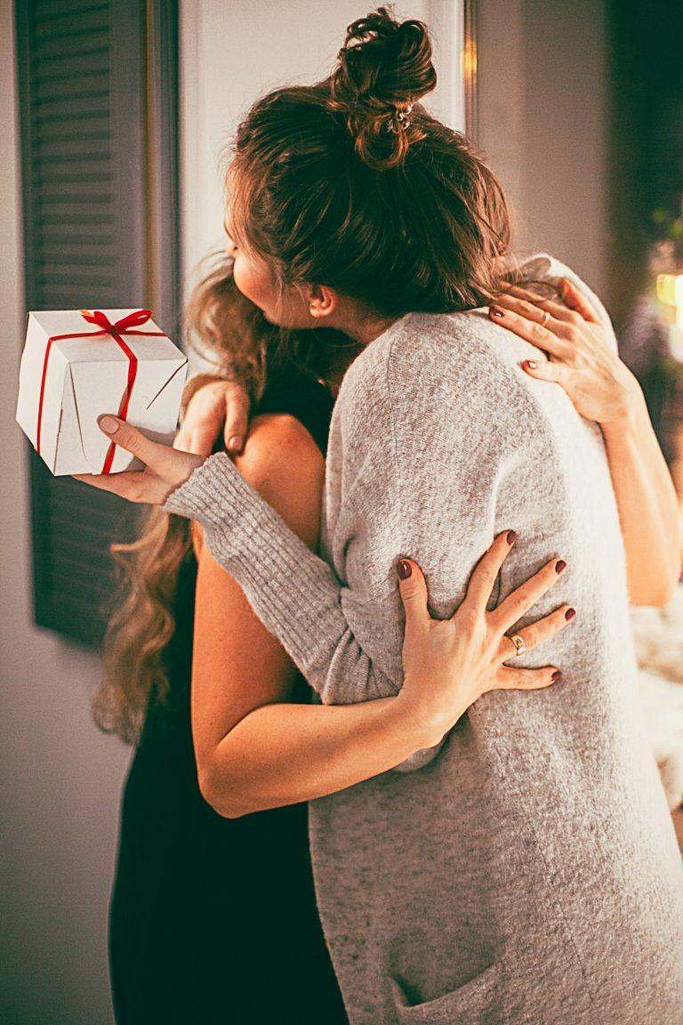 Two family members embrace at Christmas.