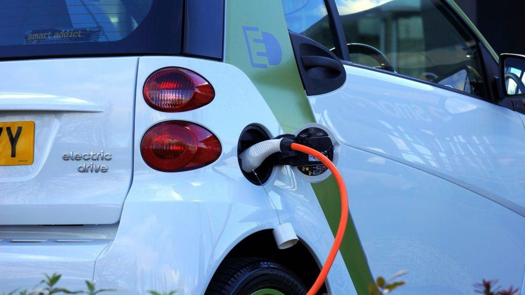 An electric car recharging at a recharge point.