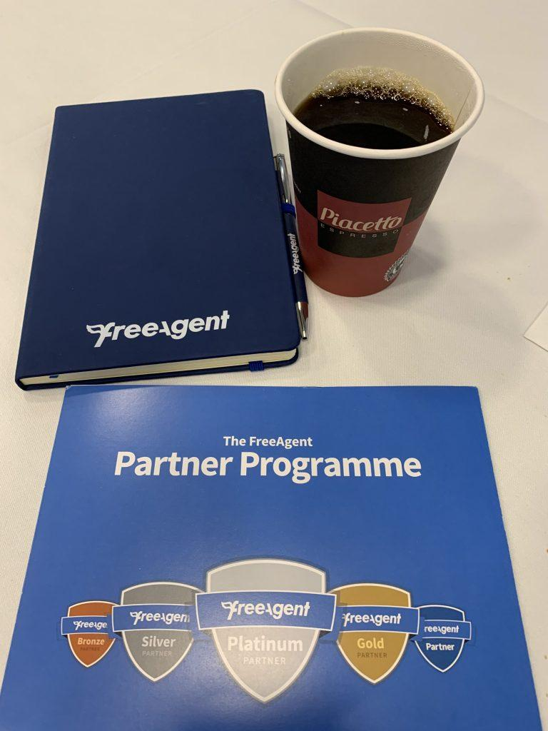 A FreeAgent notebook and introduction to their Partner Programme guide.