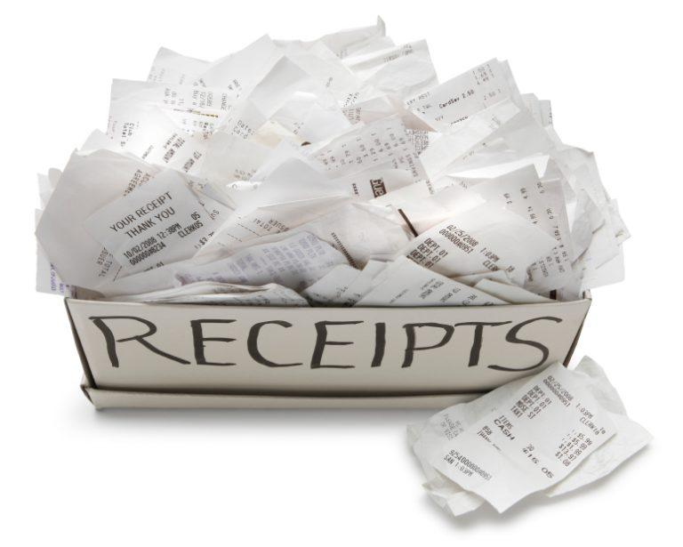 A receipts box overflowing with receipts.